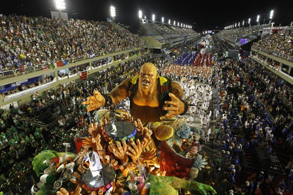 Dancers of Grande Rio samba school parade on a float during carnival celebrations at the Sambadrome in Rio de Janeiro, Brazil, Tuesday, Feb. 21, 2012.  Nearly 100,000 paying spectators turn out for the all-night spectacle at the Sambadrome. (AP Photo/Victor R. Caivano)