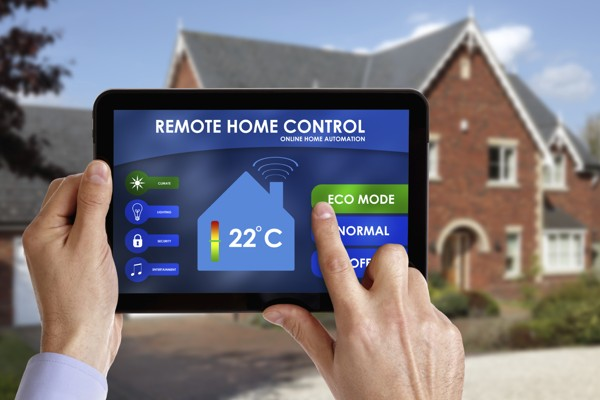 Holding a smart energy controller or remote home control online home automation system on a digital tablet. All screen graphics made up.