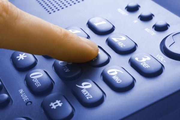 finger with blue telephone keypad - communication concept