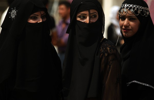 Iraqi female students wearing Arab folkloric dresses and Bedouin masks take part in a graduation party at the Baghdad IT and Technology University as they celebrate on April 06, 2009. There were 57,500 students and 5,300 lecturers at Baghdad University in 2005 -- before the violence spun out of control, taking students, lecturers and staff members with it over the abyss.The last figures give 162 teachers killed by insurgents -- who have targeted academics, journalists, poets and intellectuals in particular -- since the US invasion in 2003. AFP PHOTO / PATRICK BAZ (Photo credit should read PATRICK BAZ/AFP/Getty Images)