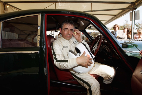 CHICHESTER, UNITED KINGDOM - SEPTEMBER 15:  Actor Rowan Atkinson sits in his car after the St. Mary's trophy during the Goodwood Revival 2012 on September 15, 2012 in Chichester, United Kingdom.  (Photo by Andreas Rentz/Getty Images)