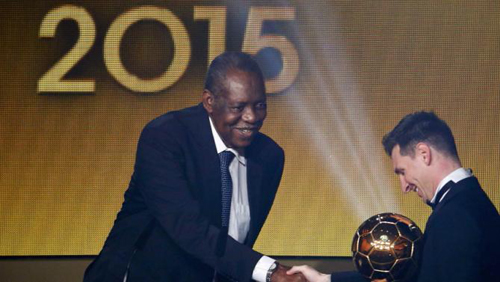 FIFA acting president Hayatou congratulates FC Barcelona's Messi of Argentina with winning the FIFA Ballon d'Or 2015 award for the world player of the year at a ceremony in Zurich