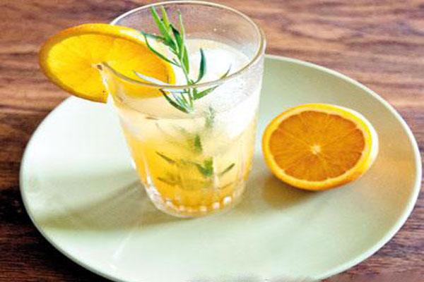 Tarragon and orange sunset cocktail drink